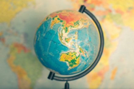 Where in the World is ACT? Yaroslav Prokopenko, Globe on a blurred background of the political map of the world.