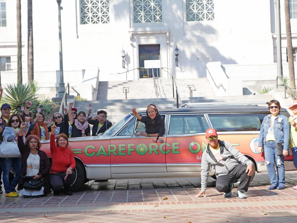 Marisa Morán Jahn, CareForce One at a rally on steps of City Hall, Los Angeles from CareForce One Travelogues, 2016 Courtesy of the artist. Photo: Marc Shavitz